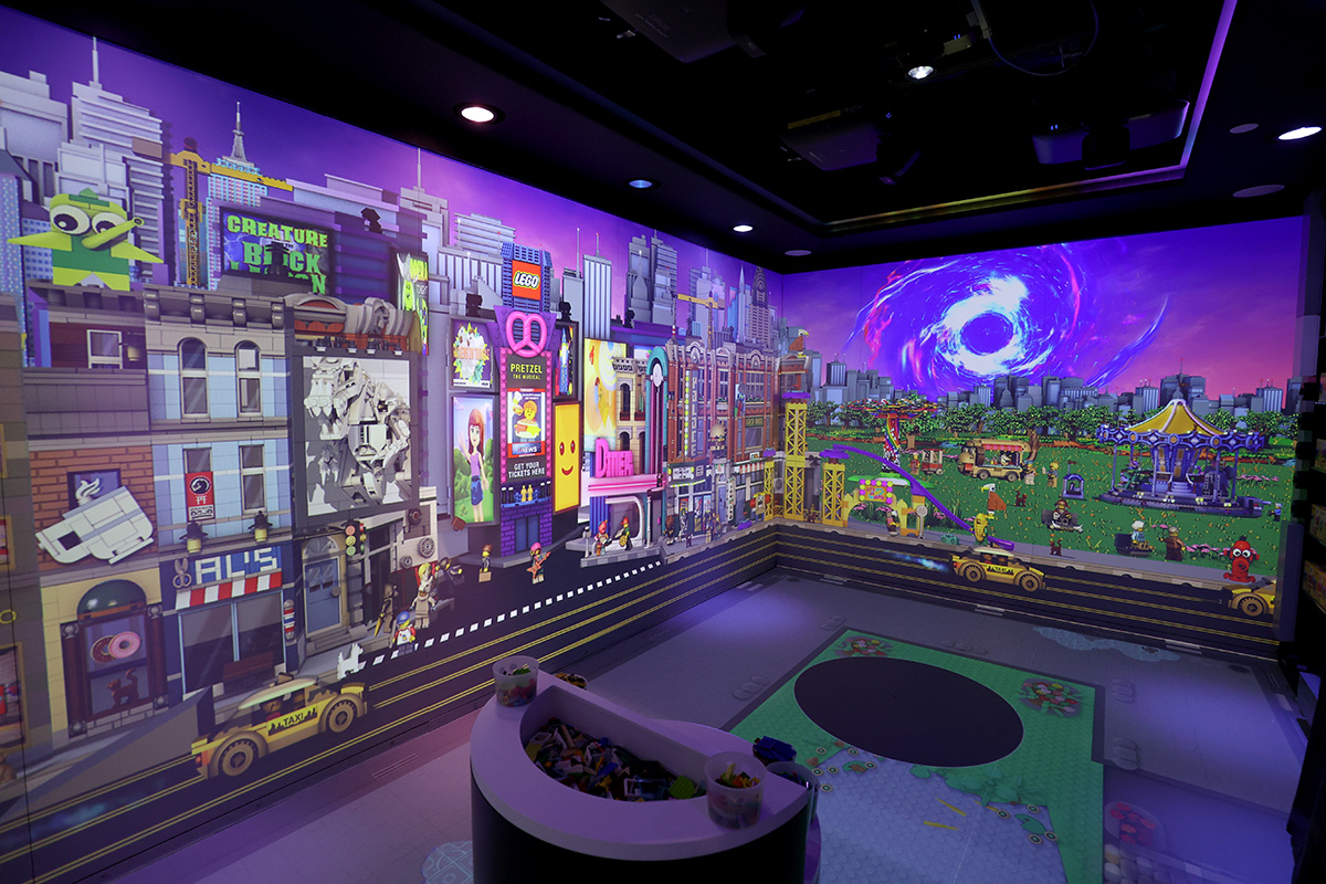 The Brick Lab features a 20-minute themedexperience with interactive animated content, lighting, sound and music, including the ability to build a creation, scan the build and watch it become part of the Brick Lab.