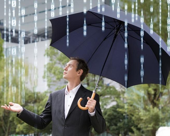 a person that is standing in the rain holding an umbrella