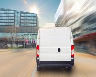 a van driving down a street